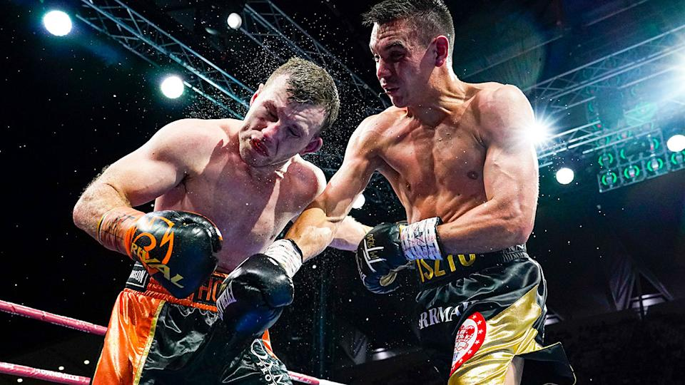 Seen here, Tim Tszyu hits Jeff Horn with a massive shot in their Townsville bout.