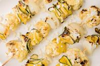 """<p>Shaving the <a href=""""https://www.delish.com/uk/food-news/a32614373/how-to-cook-courgette/"""" rel=""""nofollow noopener"""" target=""""_blank"""" data-ylk=""""slk:courgette"""" class=""""link rapid-noclick-resp"""">courgette</a> into long strips and then curling them creates a gorgeous effect.</p><p>Get the <a href=""""https://www.delish.com/uk/cooking/recipes/a33319464/zucchini-cauliflower-skewers-feta-recipe/"""" rel=""""nofollow noopener"""" target=""""_blank"""" data-ylk=""""slk:Grilled Courgette and Cauliflower Skewers with Feta"""" class=""""link rapid-noclick-resp"""">Grilled Courgette and Cauliflower Skewers with Feta</a> recipe.</p>"""