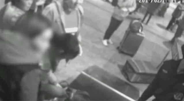 The woman reportedly didn't trust train security staff with her handbag. Source: PearVideo