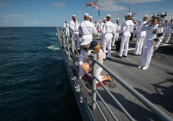 US Navy Lieutenant Commander Paul Nagy, USS Philippine Sea, and Carol Armstrong, wife of Neil Armstrong, commit the cremains of Neil Armstrong to sea during a burial at sea service held onboard the USS Philippine Sea (CG 58), Friday, Sept. 14,