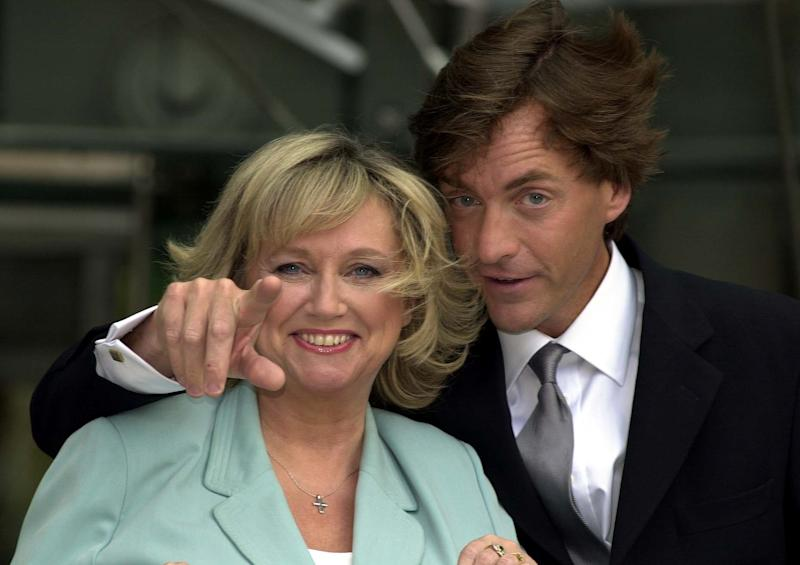 TV presenters Richard Madeley and Judy Finnigan outside the Channel 4 building in London after announcing a two-year deal with the channel. The TV hosts are quitting ITV's This Morning after 13 years to present a Channel 4 chat show. * The pair said there had been no bidding war between channels, but they simply wanted to try something different. They are due to move to Channel 4 in the autumn when their current contract with Granada runs out.
