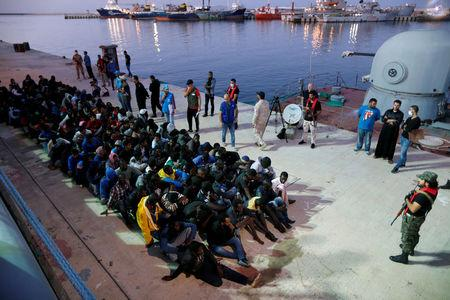 FILE PHOTO: Migrants arrive at a naval base after they were rescued by Libyan Navy, in Tripoli, Libya November 4, 2017. REUTERS/Ahmed Jadallah