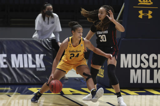 California's Evelien Lutje Schipholt (24) drives against Stanford's Haley Jones (30) during the first half of an NCAA college basketball game Sunday, Dec. 13, 2020, in Berkeley, Calif. (AP Photo/Jed Jacobsohn)