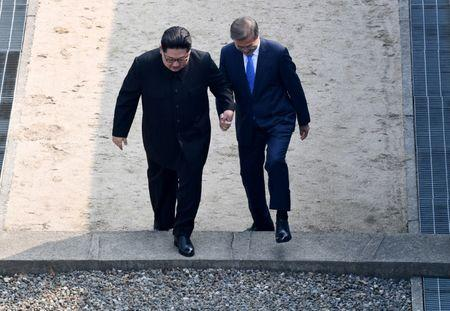South Korean President Moon Jae-in and North Korean leader Kim Jong Un meet in the truce village of Panmunjom inside the demilitarized zone separating the two Koreas, South Korea, April 27, 2018.     Korea Summit Press Pool/Pool via Reuters