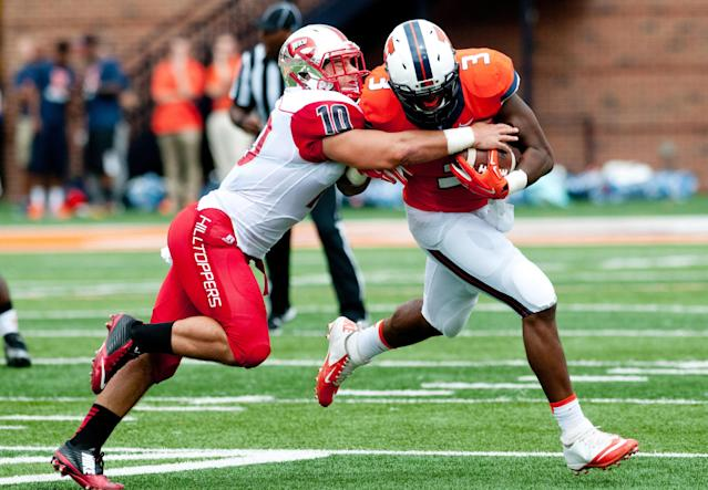 Illinois tight end Jon Davis (3) is tackled by Western Kentucky linebacker Nick Holt (10) during the first quarter of an NCAA college football game, Saturday, Sep. 6, 2014, at Memorial Stadium in Champaign, Ill. (AP Photo/Bradley Leeb)
