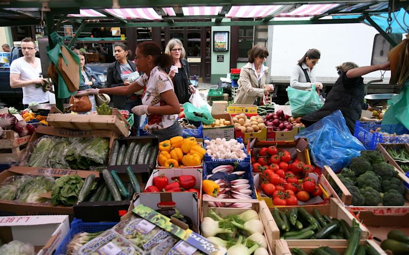 A fruit and vegetable market stall on Portobello road in west London -  Clara Molden