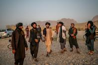 Young members of the Taliban dance and sing next to a river near Kandahar (AFP/Bulent KILIC)