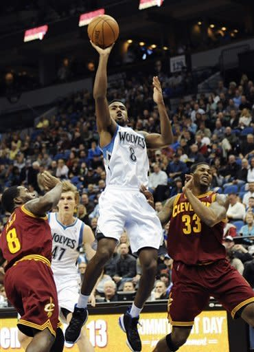 Minnesota Timberwolves' Malcolm Lee, center, shoots between Cleveland Cavaliers' Jeremy Pargo, left, and Alonzo Gee (33) in the first half of an NBA basketball game, Friday, Dec. 7, 2012, in Minneapolis. (AP Photo/Jim Mone)