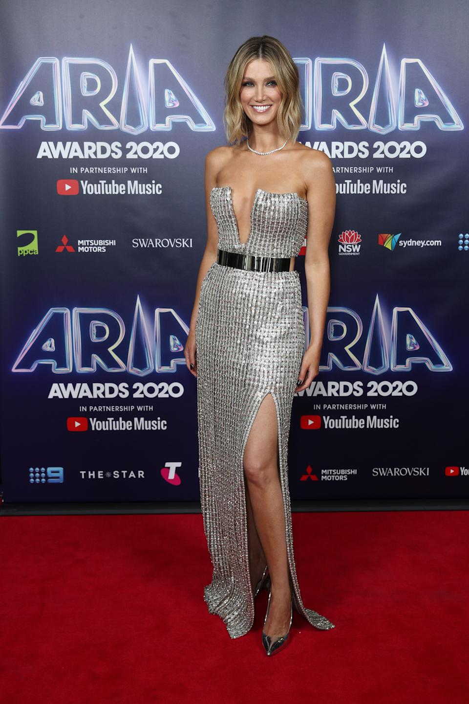 Delta Goodrem wears a sparkling silver strapless gown on the red carpet at the 2020 ARIA Awards at The Star on November 24, 2020 in Sydney, Australia.
