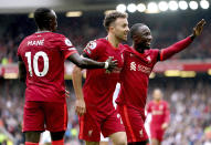Liverpool's Diogo Jota, center, celebrates scoring with teammates during the English Premier League soccer match between Liverpool and Burnley at Anfield, Liverpool, England, Saturday Aug. 21, 2021. (Mike Egerton/PA via AP)