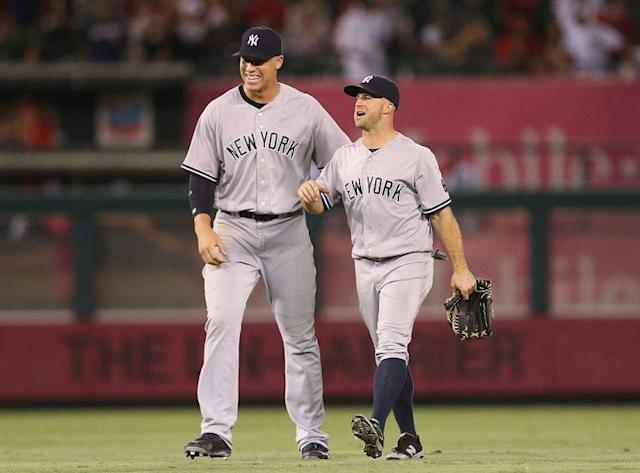 Aaron Judge, towering over teammates. (Photo by Stephen Dunn/Getty Images)