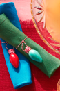 """<p>Don't be so quick to toss your unusable Christmas bulbs in the trash. Consider turning them into festive napkin rings. Just place a loop of red and white baker's twine at the bottom of each bulb with hot glue. Then, tie your new creations around colorful rolled napkins.<strong><br></strong></p><p><strong>RELATED: </strong><a href=""""https://www.goodhousekeeping.com/holidays/christmas-ideas/g29322048/christmas-living-room-decor-ideas/"""" rel=""""nofollow noopener"""" target=""""_blank"""" data-ylk=""""slk:32 Cozy Christmas Living Room Ideas"""" class=""""link rapid-noclick-resp"""">32 Cozy Christmas Living Room Ideas</a></p>"""