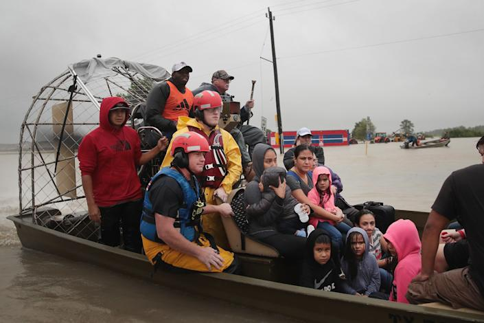 People are rescued from a flooded neighborhood in Houston.
