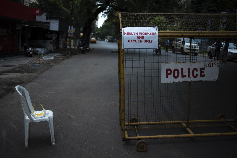 A signage is displayed on a barricade erected by police as part of imposing a lockdown to curb the spread of coronavirus in Kochi, Kerala state, India, Saturday, May 8, 2021. Kerala, which emerged as a blueprint for tackling the pandemic last year, began a lockdown on Saturday. (AP Photo/R S Iyer)
