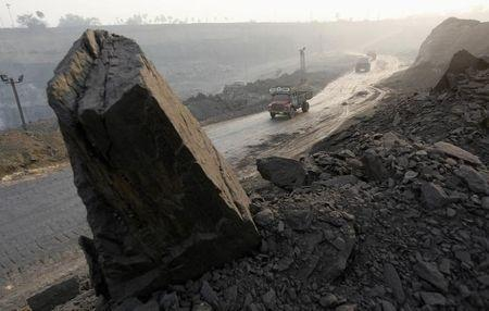 Trucks move along a road in the Mahanadi coal fields near Talcher town, in Orissa March 28, 2012. REUTERS/Rupak De Chowdhuri/Files