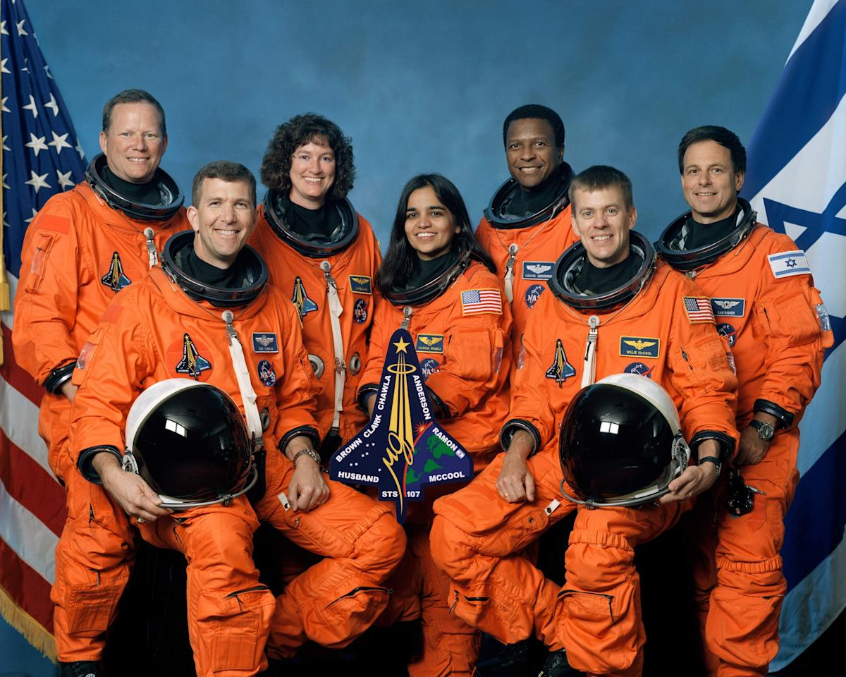 UNDATED FILE PHOTO:  The crew of Space Shuttle Columbia's mission STS-107 take a break from their training regime to pose for the traditional crew portrait. Seated in front are astronauts Rick D. Husband (L), mission commander; Kalpana Chawla, mission specialist; and William C. McCool, pilot. Standing are (L to R) astronauts David M. Brown, Laurel B. Clark, and Michael P. Anderson, all mission specialists; and Ilan Ramon, payload specialist representing the Israeli Space Agency. The one-year anniversary of the space shuttle Columbia disaster during re-entry will be marked February 1, 2004.   (Photo by NASA/Getty Images)