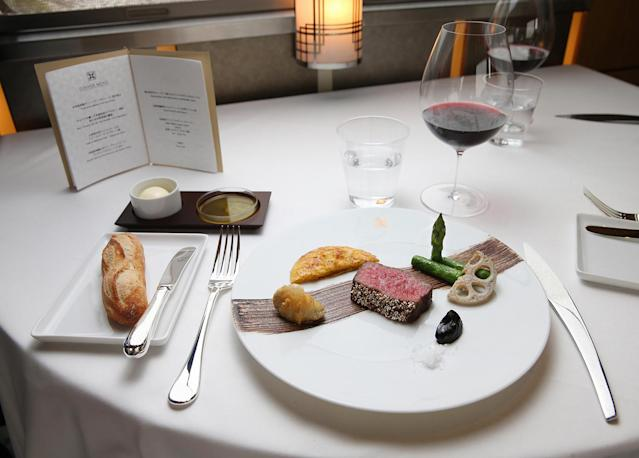<p>Guests aboard the Train Suite Shiki-shima can select from a menu devised by a Michelin-starred chef. (Photo: Asahi Shimbun via Getty Images) </p>