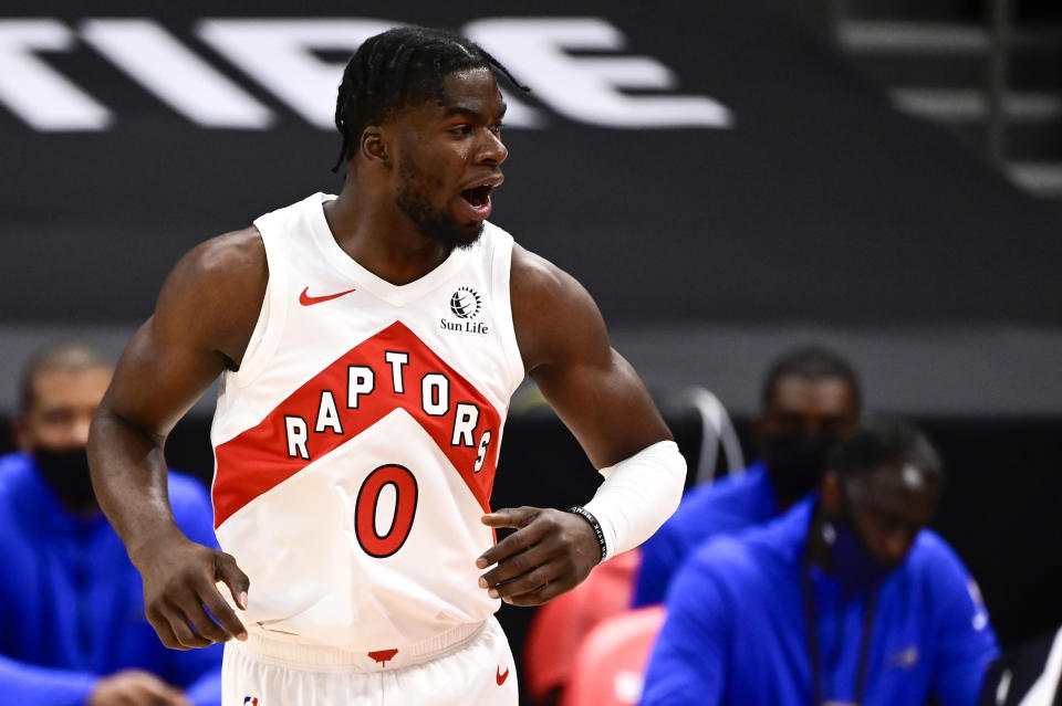 TAMPA, FLORIDA - JANUARY 31: Terence Davis #0 of the Toronto Raptors reacts during the first quarter against the Orlando Magic at Amalie Arena on January 31, 2021 in Tampa, Florida. NOTE TO USER: User expressly acknowledges and agrees that, by downloading and or using this photograph, User is consenting to the terms and conditions of the Getty Images License Agreement. (Photo by Douglas P. DeFelice/Getty Images)