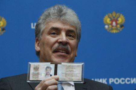 Businessman Pavel Grudinin, representing the Russian Communist Party, demonstrates his identity document after he was registered as a candidate in the upcoming presidential election the Central Election Commission headquarters in Moscow, Russia January 12, 2018. REUTERS/Sergei Karpukhin