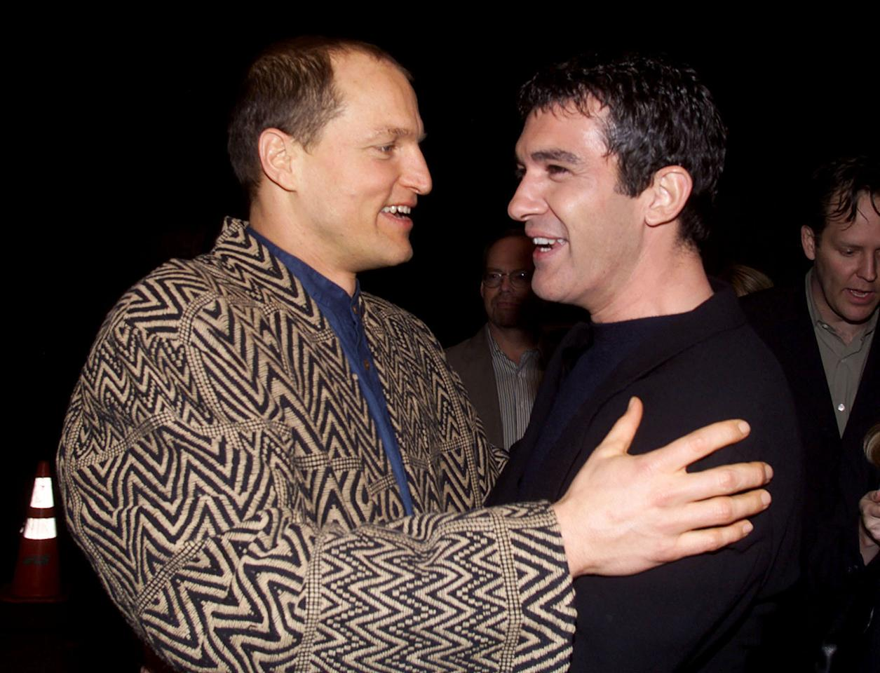 """Actors Antonio Banderas (L) and Woody Harrelson greet each other as they arrive at the premiere of their new film """"Play It To The Bone"""" January 10 in Hollywood. The film which, opens January 21 in the United States, is about two boxers as they travel to Las Vegas to fight for the first time."""