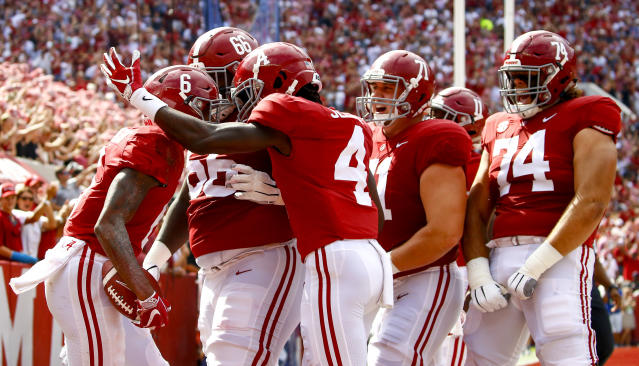 Alabama wide receiver DeVonta Smith (6) celebrates with teammates after scoring a touchdown during the first half of an NCAA college football game against Texas A&M, Saturday, Sept. 22, 2018, in Tuscaloosa, Ala. (AP Photo/Butch Dill)