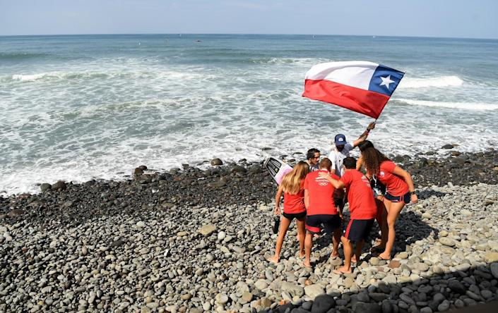 Team Chile cheers after competing in the ISA World Surfing Games at Surf City in El Salvador.
