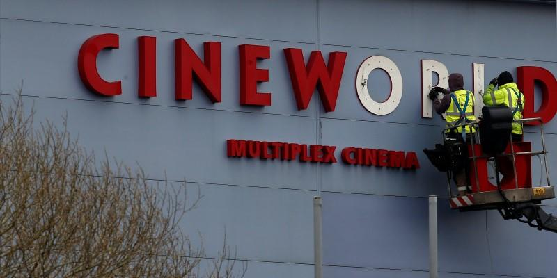 FILE PHOTO Workers repair a sign at a Cineworld cinema in Bradford northern England.