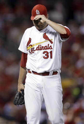 St. Louis Cardinals starting pitcher Lance Lynn walks off the field after working the fifth inning of a baseball game against the Kansas City Royals on Wednesday, May 29, 2013, in St. Louis. (AP Photo/Jeff Roberson)