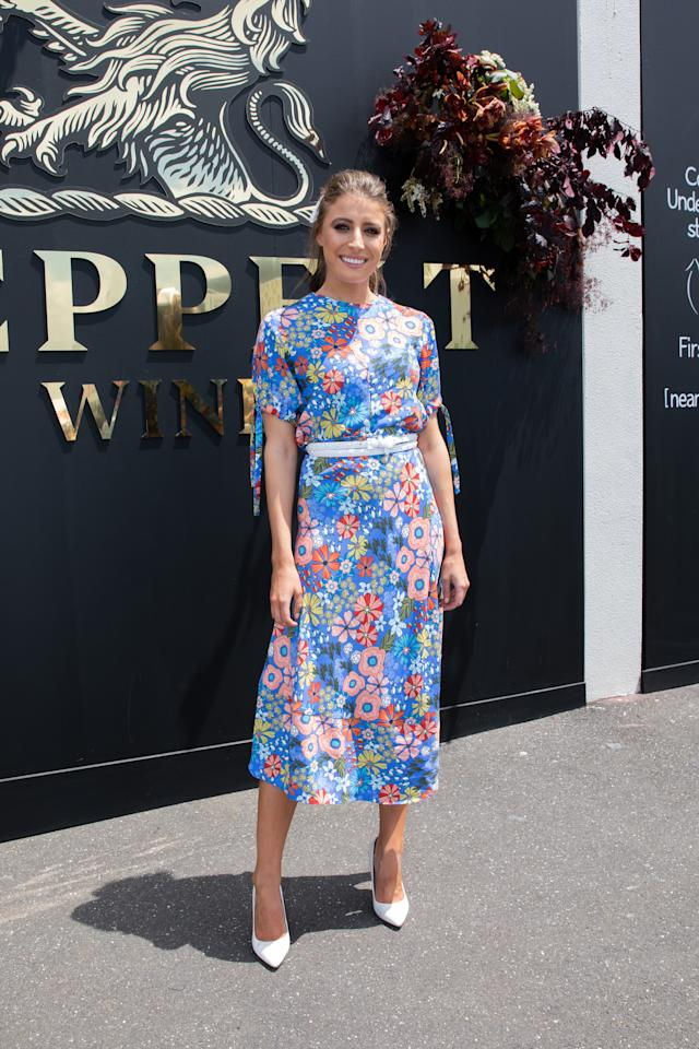 <p>Model Rebecca teams patterned her blue frock with white heels. Photo: Getty </p>