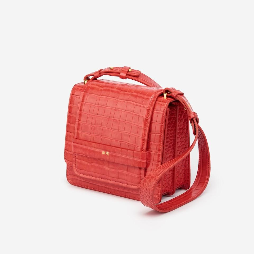 """Sustainability and ethics are core to <a href=""""https://www.jwpei.com/"""">JW Pei</a>'s values: Its handbags are made from vegan leather and recycled materials (and you can read all about the factory where they're made on its website). The designs are timeless but still attainable in terms of price point, starting at $129. You'll definitely feel good when you wear them. $235, JW Pei. <a href=""""https://www.jwpei.com/collections/2019-s-s-collection/products/the-fiona-bag-red-croc"""">Get it now!</a>"""