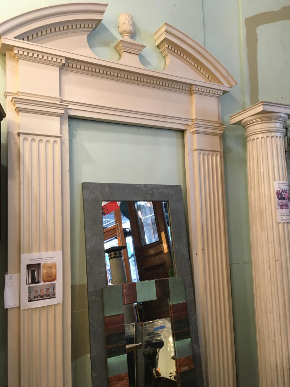 """This Oct. 15, 2019 photo shows the salvaged doorframe of the Waldorf-Astoria Hotel's presidential suite, available for sale at Olde Good Things salvage store in New York. Two of the hottest trends in home decor are sustainability and authenticity. """"It's about both history and sustainability,"""" says Madeline Beauchamp of Olde Good Things, one of the oldest architectural salvage businesses in the country, with one shop in Los Angeles, another in Scranton, Pennsylvania, two stores in New York, and a flagship store to open soon in Midtown Manhattan. (Katherine Roth via AP)"""