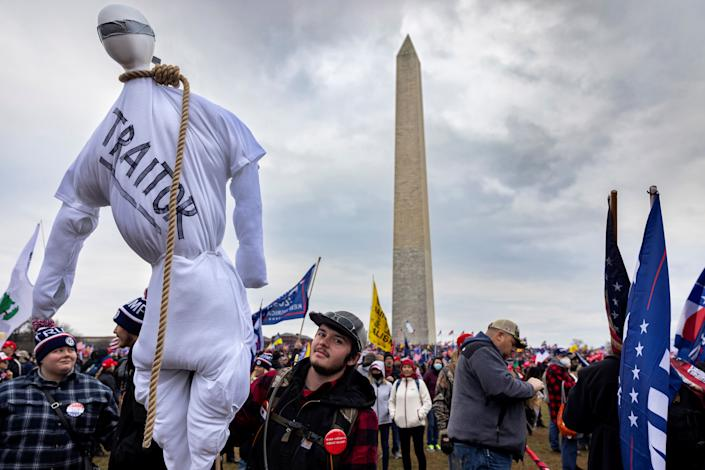 A pro-Trump protestor holds an effigy with a noose around its neck at Trump's rally that preceded the insurrection. (Photo: Brent Stirton via Getty Images)