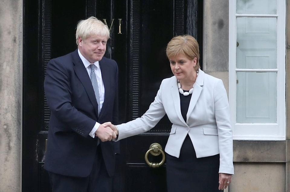 Nicola Sturgeon with Boris Johnson during a previous visit to Bute House (Jane Barlow/PA) (PA Archive)