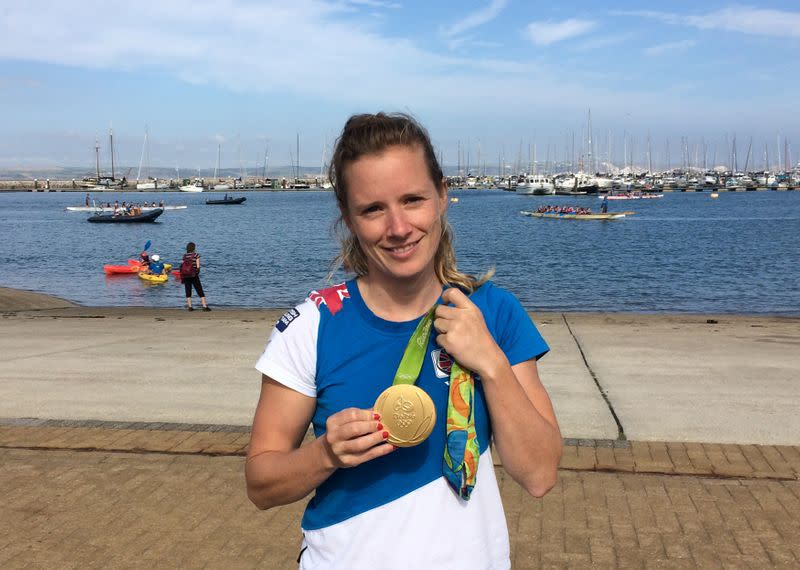 British Olympic sailor Hannah Mills poses in Weymouth and Portland, Britain with the gold medal she won at the 2016 Rio Olympics