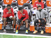 From left to right, Atlanta Hawks center Clint Capela, forward Solomon Hill and guard Trae Young watch from the bench in the final minutes of a loss to the Milwaukee Bucks during Game 2 of the NBA Eastern Conference basketball finals game Friday, June 25, 2021, in Milwaukee. (Curtis Compton/Atlanta Journal-Constitution via AP)