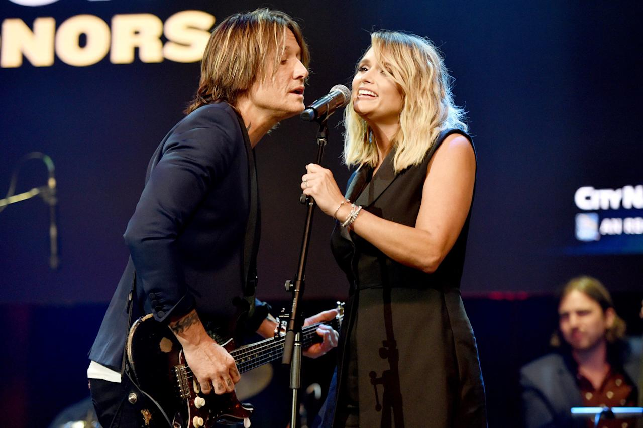 Keith Urban and Miranda Lambert share the mic during their performance at the 13th annual ACM Honors on Wednesday at the Ryman Auditorium in Nashville.