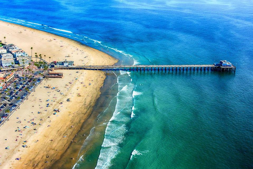 """<p>Whether you're planning a vacation with your family, your spouse, or solo, Newport Beach offers something for everyone. This popular beach located between L.A. and San Diego is filled with plenty of activities for beach goers, like surfing, sailing, sunset cruises, and <a href=""""https://newportwhales.com/whalewatchingprices.html?gclid=Cj0KCQjwoaz3BRDnARIsAF1RfLdykuzBPG94rnk0-UadVSy_a-qr-CcBmRb0NOa_POiOMj-bC2vGQaYaAn2TEALw_wcB"""" rel=""""nofollow noopener"""" target=""""_blank"""" data-ylk=""""slk:whale watching tours"""" class=""""link rapid-noclick-resp"""">whale watching tours</a>. <a href=""""https://www.newportbeachca.gov/how-do-i-/find/biking-walking-trails"""" rel=""""nofollow noopener"""" target=""""_blank"""" data-ylk=""""slk:Bike and walking trails"""" class=""""link rapid-noclick-resp"""">Bike and walking trails</a> weave along the coast, offering breathtaking views of the crystal blue ocean. Hot spots include <a href=""""https://www.californiabeaches.com/beach/balboa-pier-beach/"""" rel=""""nofollow noopener"""" target=""""_blank"""" data-ylk=""""slk:Balboa Pier Beach"""" class=""""link rapid-noclick-resp"""">Balboa Pier Beach</a>, <a href=""""https://www.visitnewportbeach.com/beaches-and-parks/newport-municipal-beach/"""" rel=""""nofollow noopener"""" target=""""_blank"""" data-ylk=""""slk:Newport Municipal Beach"""" class=""""link rapid-noclick-resp"""">Newport Municipal Beach</a>, and <a href=""""https://www.parks.ca.gov/?page_id=652"""" rel=""""nofollow noopener"""" target=""""_blank"""" data-ylk=""""slk:Corona del Mar State Beach"""" class=""""link rapid-noclick-resp"""">Corona del Mar State Beach</a>. <br></p>"""