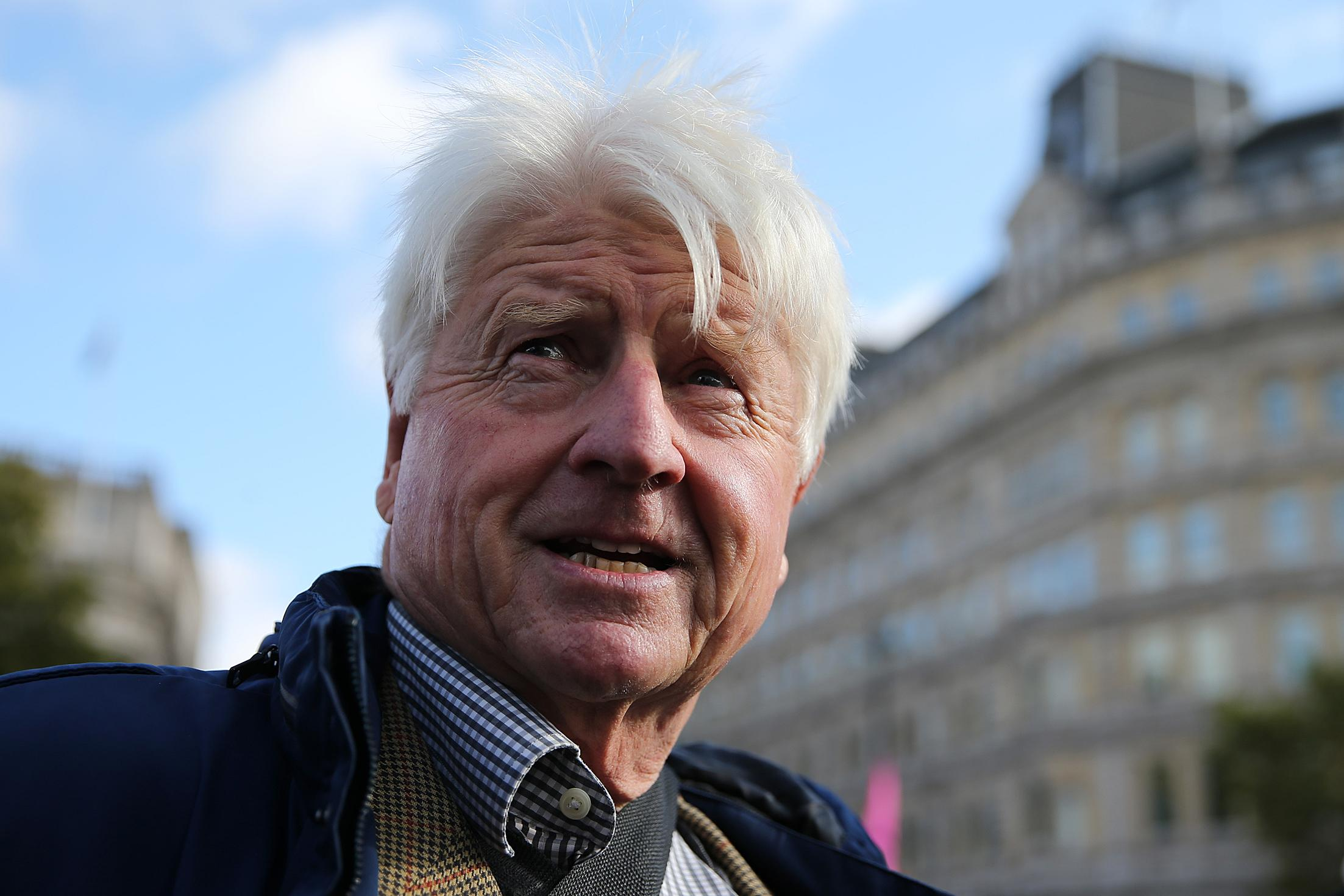 Stanley Johnson, father of Britain's Prime Minister Boris Johnson, arrives to speak on stage at Trafalgar Square, during the third day of climate change demonstrations by the Extinction Rebellion group in central London, on October 9, 2019. - Demonstrations occurred in 60 cities around the world this week, with thousands taking to the streets of New Delhi, Cape Town, Paris, Vienna, Madrid, and Buenos Aires. Extinction Rebellion is demanding that governments drastically cut carbon emissions. (Photo by ISABEL INFANTES / AFP) (Photo by ISABEL INFANTES/AFP via Getty Images)
