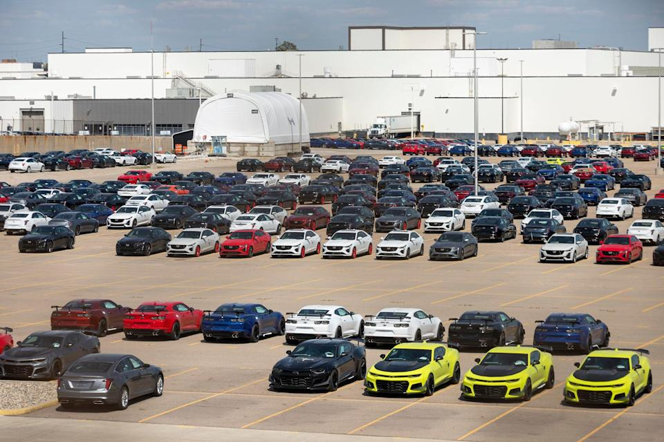 Parked Chevy Camaros and Cadillac CT4s and CT5s in the parking lot of GM Lansing Grand River Assembly on May 14, 2021, in Lansing.