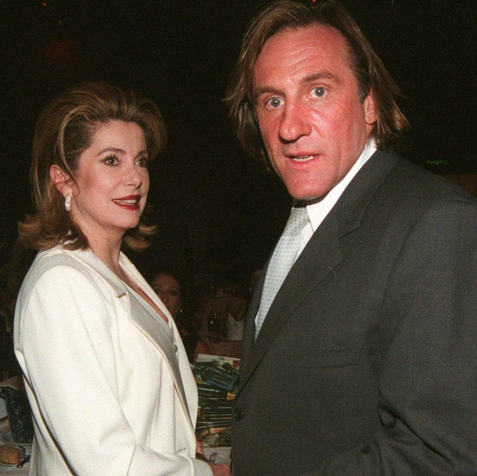 Depardieu with his his friend and sometime defender Catherine Deneuve, in 1998 - AP