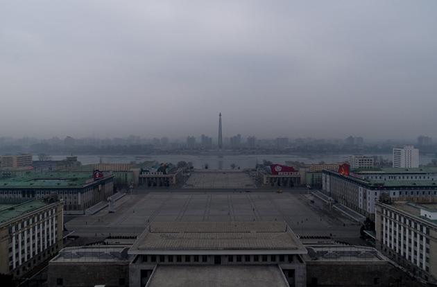 Juche tower and Kim Il-sung square as seen from the Grand Peopleís Study House in Pyongyang. The building at the bottom of the frame is where Kim Il-sung, Kim Jong-il and Kim Jong-un stand to view military parades that come through the square.
