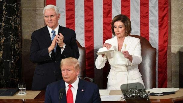 PHOTO: Vice President Mike Pence claps as Speaker of the House Nancy Pelosi rips a copy of President Donald Trump speech after he delivers the State of the Union address at the US Capitol in Washington, Feb. 4, 2020. (Mandel Ngan/AFP via Getty Images)