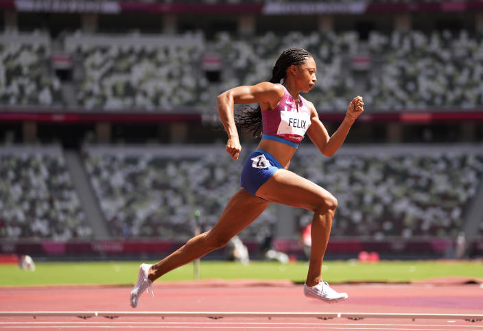 Allyson Felix, of United States races in a women's 400-meter heat at the 2020 Summer Olympics, Tuesday, Aug. 3, 2021, in Tokyo, Japan. (AP Photo/Martin Meissner)
