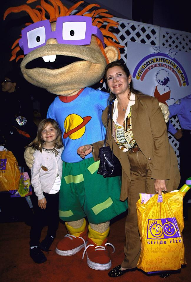Fisher and Billie attend a <em>Rugrats</em>-themed benefit for the Children Affected by AIDS Foundation in 1991.