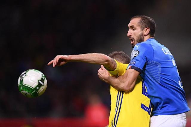 Defender Giorgio Chiellini was part of the Italy team that lost a World Cup playoff to Sweden but will miss two upcoming friendlies (AFP Photo/Marco BERTORELLO)