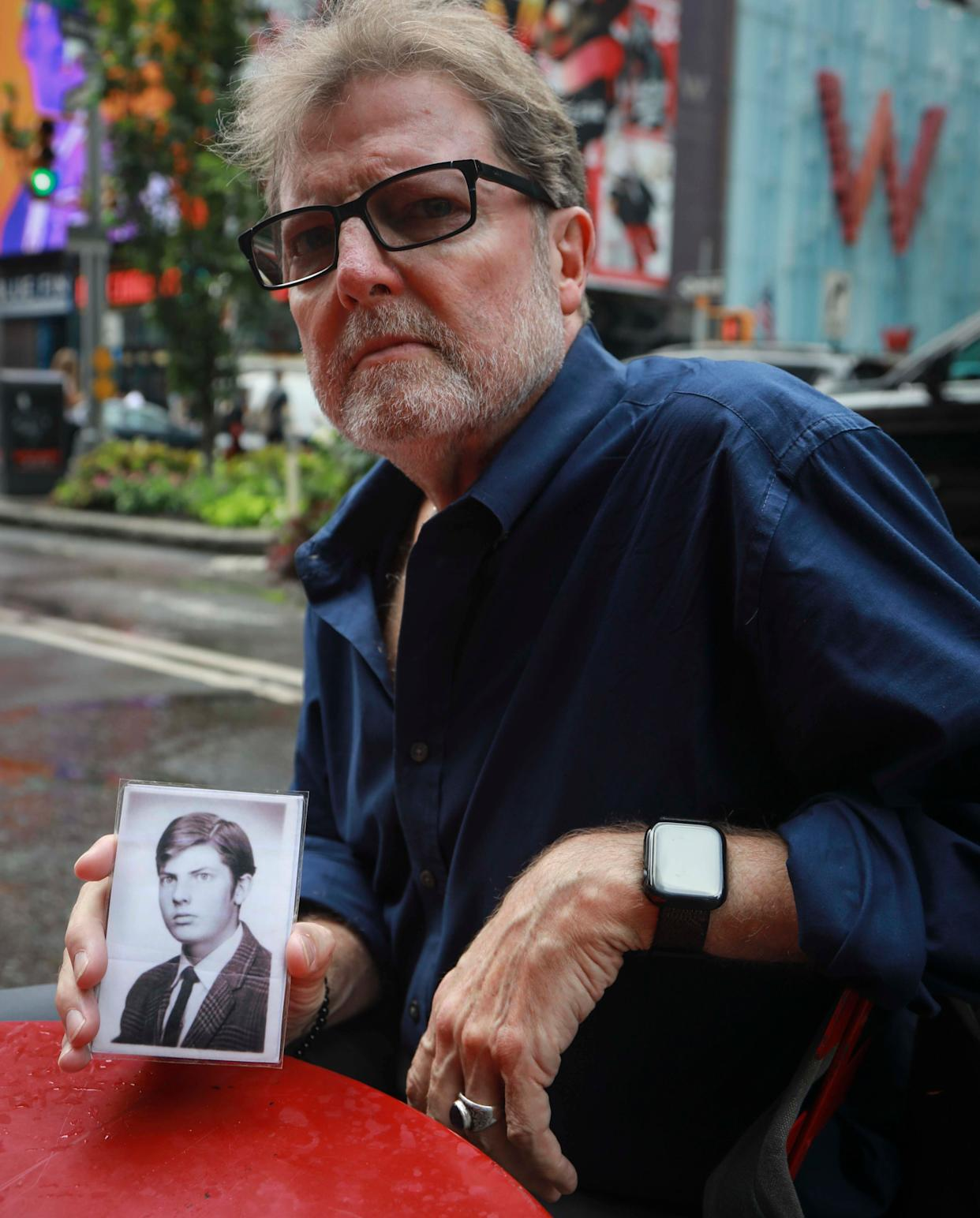 Brian Toale, a 66-year-old who says he was molested by an employee at a Catholic high school in Long Island, holds a photo of himself at 16 years old. (Photo: Bebeto Matthews/ASSOCIATED PRESS)