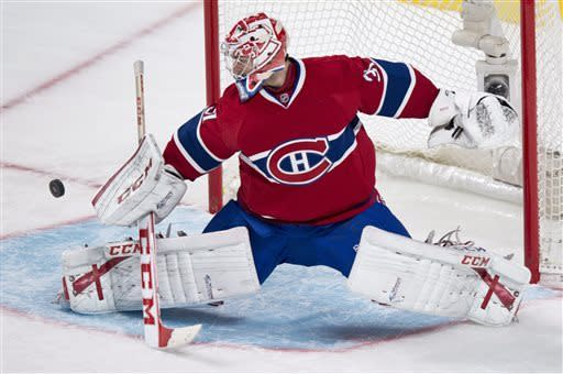 Montreal Canadiens goalie Carey Price deflects a shot as they face the Carolina Hurricanes during third period NHL hockey action Monday, April 1, 2013 in Montreal. The Canadiens beat the Hurricanes 4-1. (AP Photo/The Canadian Press, Paul Chiasson)