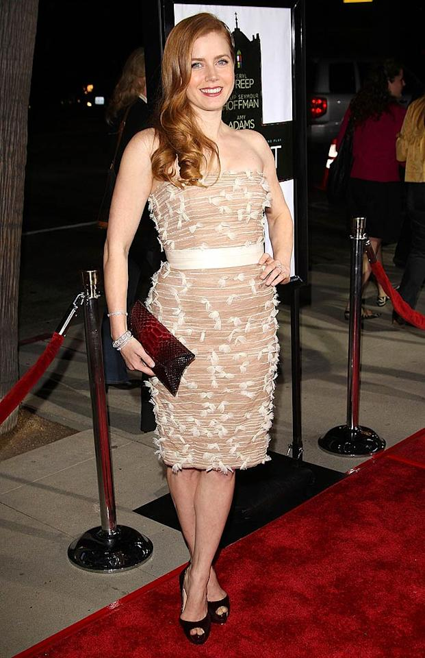 "You may think that Amy Adams' nude strapless number, complete with tulle feather detailing, looks like a winner, but we happen to think it looks like a life-size lint roller. Jason Merritt/<a href=""http://www.filmmagic.com/"" target=""new"">FilmMagic.com</a> - November 18, 2008"