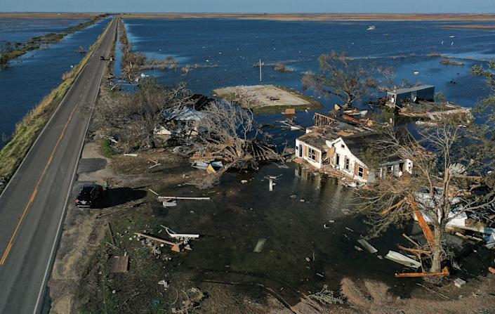 An aerial view of flood waters from Hurricane Delta surrounding structures destroyed by Hurricane Laura (R) on October 10, 2020 in Creole, Louisiana. (Mario Tama/Getty Images)