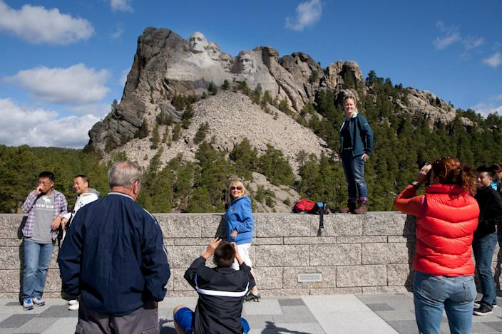 tourists take photos of themselves in front of Mount Rushmore National Memorial, on June 10, 2012 outside Keystone, South Dakota.